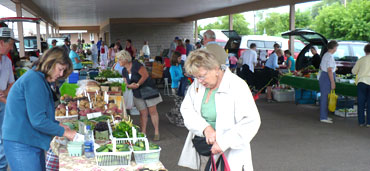 Vendors and buyers at the Market